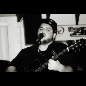 Herminie Acoustic Guitarist | Brew House Productions