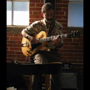 Wishon Acoustic Guitarist | Bruce Brill