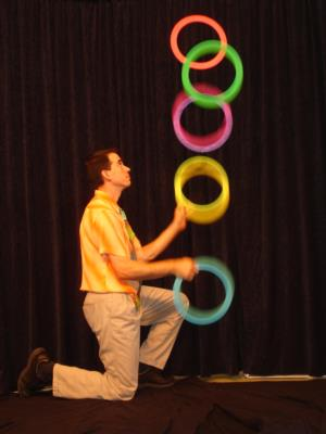 Here Nathan juggles 5 rings