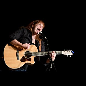 Enterprise Folk Singer | Carrie Cooley