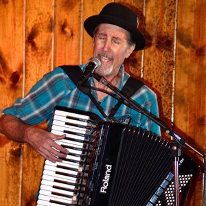 Orange Accordion Player | Dennis Gurwell Keyboards & Accordions