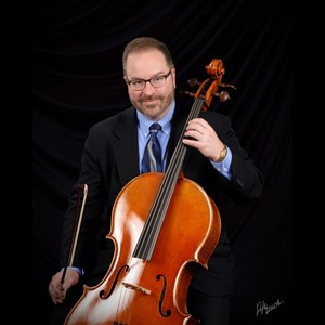 Woodstock Cellist | Rhett Barnwell