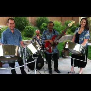 Orange Steel Drum Musician | NESTA steelband~ husband & wife team