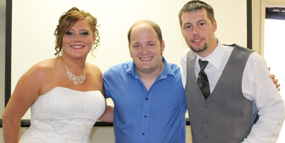 Dustin (middle,) with clients.