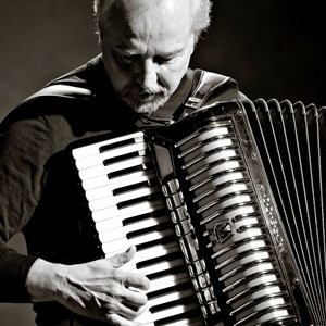 Orange Accordion Player | Al Di Cicco