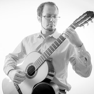 Three Springs Acoustic Guitarist | Derek Thomas Kennell