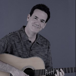 Tiro Acoustic Guitarist | Kevin Sutton