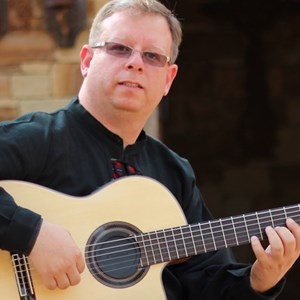Telegraph Acoustic Guitarist | Carlos Sanchez