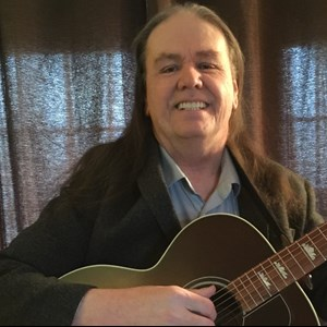 Chestnut Acoustic Guitarist | Ray Carter
