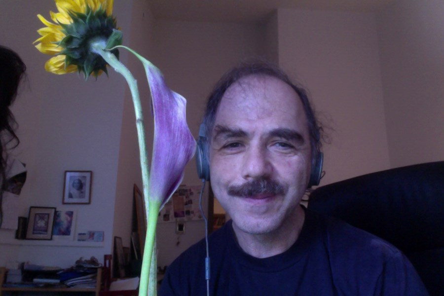 Mike at home with a flower...