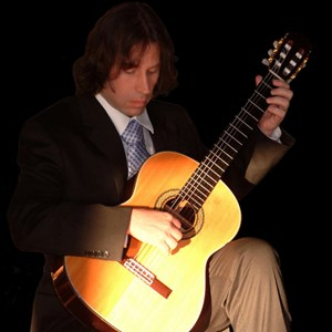 Columbus Junction Acoustic Guitarist | Dana Starkell