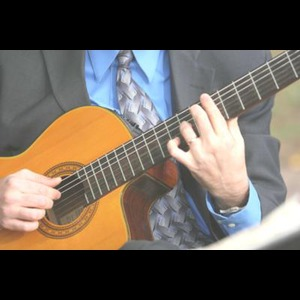 Avalon Acoustic Guitarist | Jeffrey Nowmos