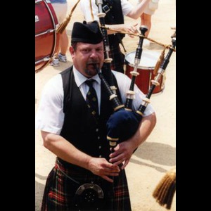 Burnham Bagpiper | Tim Carey