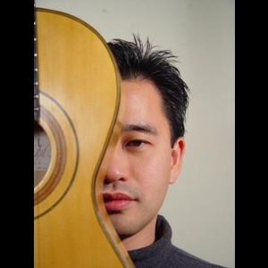 Central Point Acoustic Guitarist | Hideki Yamaya