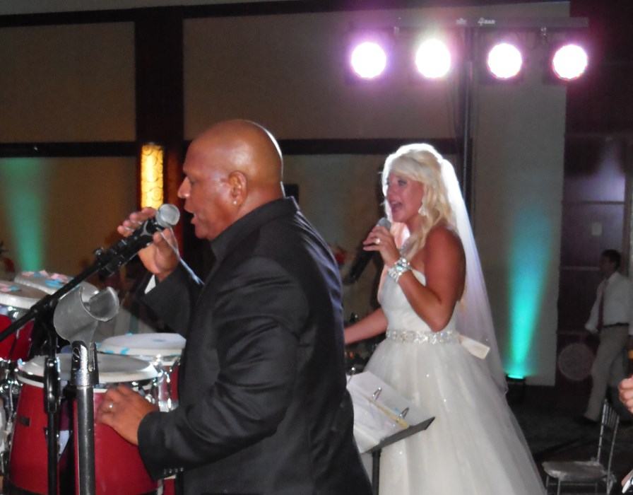 The Bride Singing with the Band