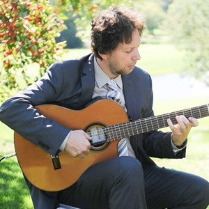 Albert Lea Acoustic Guitarist | Pavel Jany
