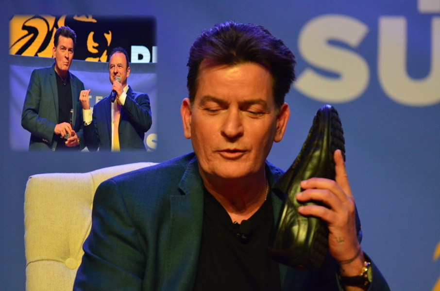 Charlie Sheen talking into his shoe