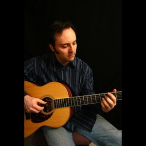 Brown Acoustic Guitarist | John Hoerr