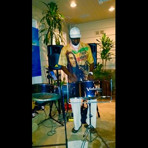 Orange Steel Drum Musician | Adontis Steeldrum