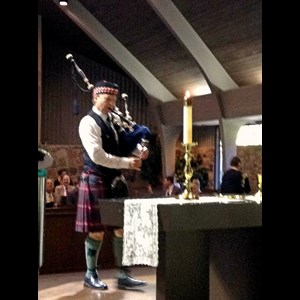 Newton Bagpiper | Tom Crawford