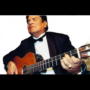 Joes Acoustic Guitarist | Manuel Molina And His Magic Guitar