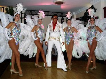 Elvis and his showgirls!