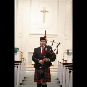 Bowman Bagpiper | Carolina Bagpipes - Mark Boesmiller
