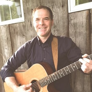 Roxbury Crossing Acoustic Guitarist | John Demers