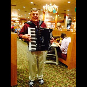 Queens Accordion Player | John Collins