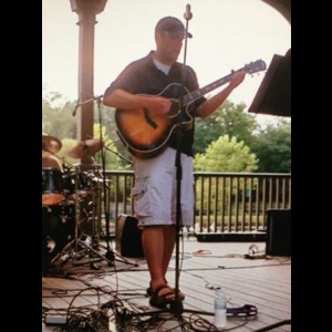 White Marsh Acoustic Guitarist | Erik MacCain